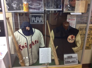 NY Knights jersey with game used bat on the left
