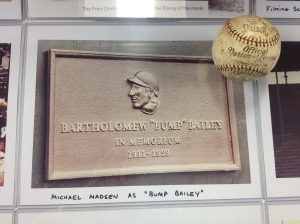 "The name plate for Bump Bailey who gave Hobbs a chance at playing because he initially lost a ball in the sun...""blinding""...then died while crashing through the wall"