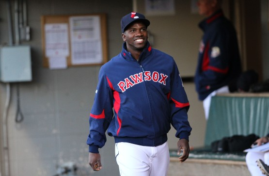 Rusney Castillo in dugout in jacket