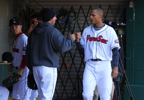 Justin Maxwell gets congrats in dugout