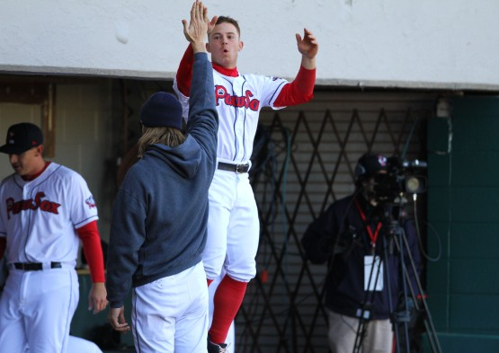 Sean Coyle jumps to give high 5s in dugout